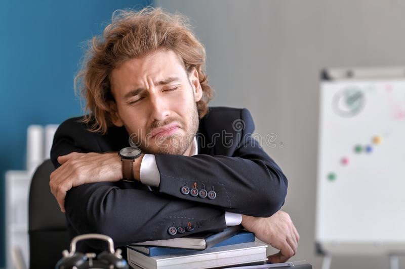 Stressed businessman missing deadlines in office stock images
