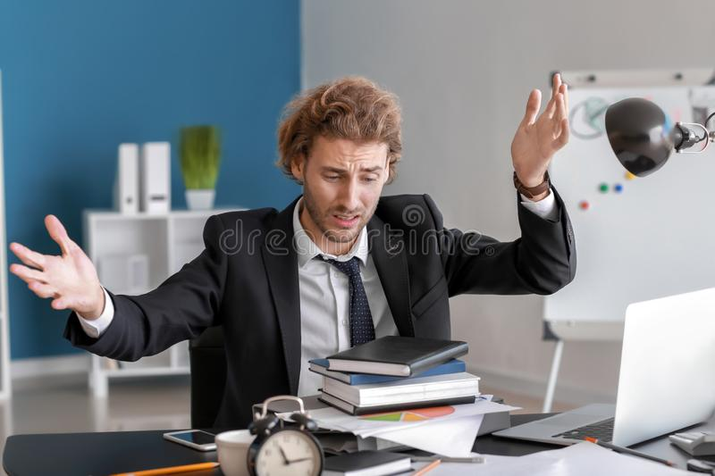 Stressed businessman missing deadlines in office royalty free stock photos