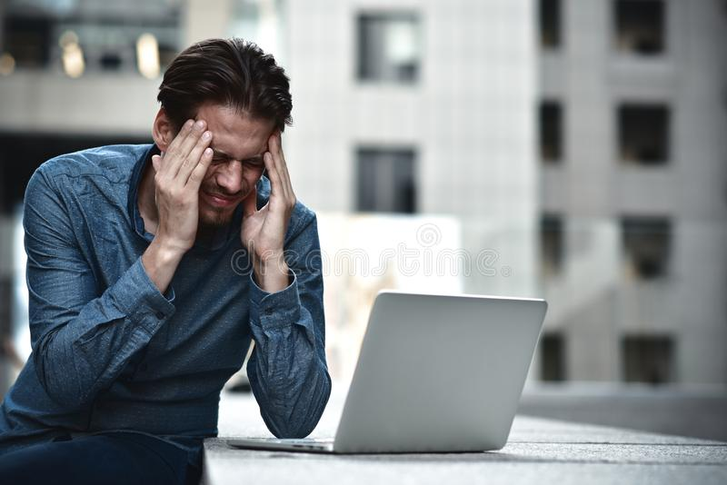 Fail. Businessman failed his project closed his face. Young freelancer make a mistake royalty free stock photography