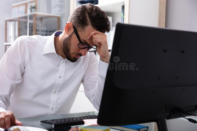 Stressed Businessman Sitting In Office royalty free stock photography