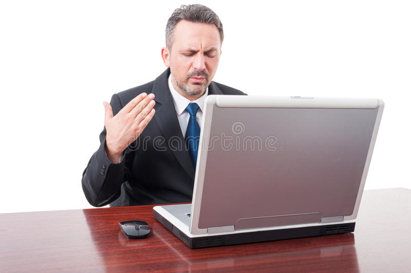 Stressed businessman sweating in his office stock photo
