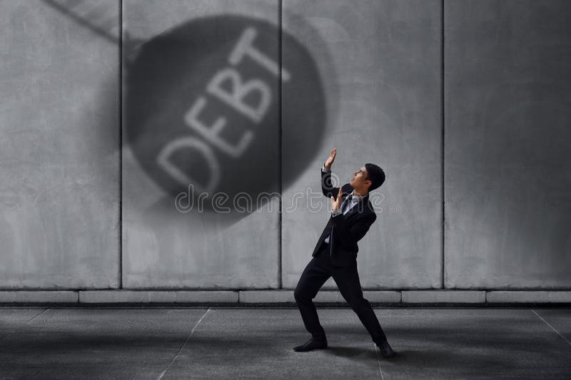 Stressed Businessman in Under Pressured Concept, Small Worker Sc royalty free stock photo