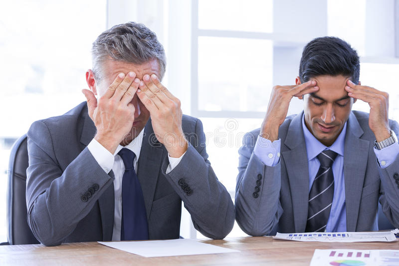 Stressed businesspeople. In the office royalty free stock photo
