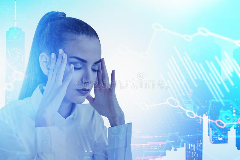 Stressed businesswoman in city, digital graph stock image