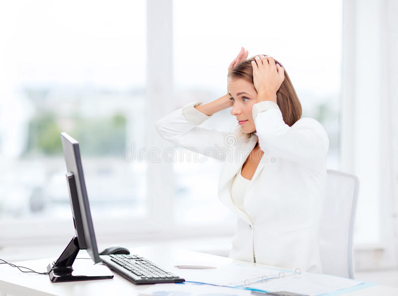 Stressed Businesswoman With Computer At Work Stock Photo