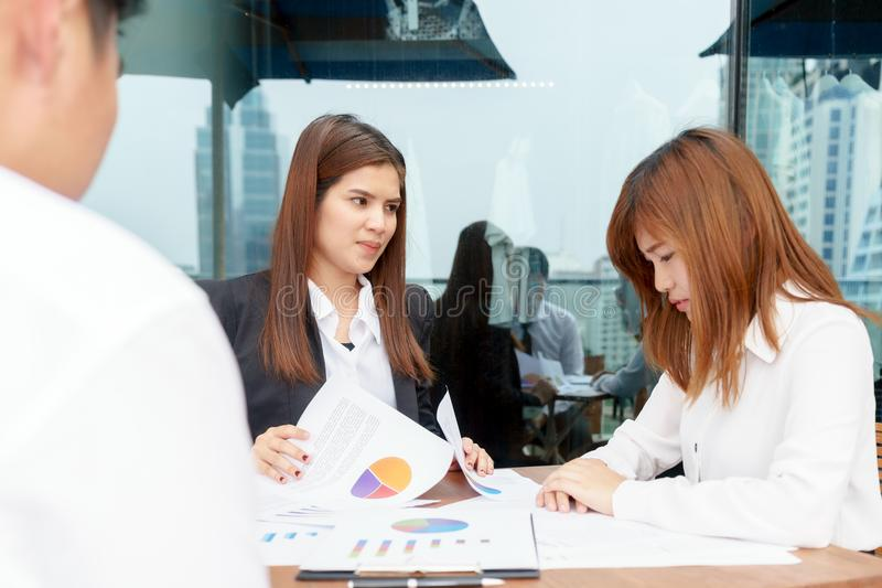 Stressed businesswoman make mistake while manager complain her. Stressed businesswoman make mistake while manager complain her royalty free stock images