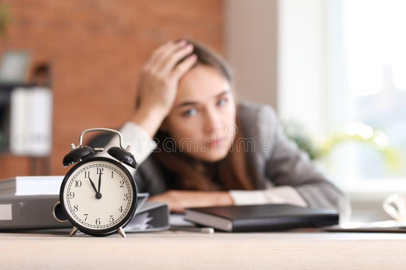 Stressed businesswoman missing deadlines in office stock photo