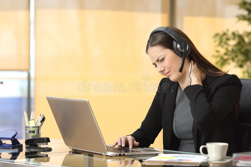 Stressed businesswoman suffering neck ache royalty free stock images