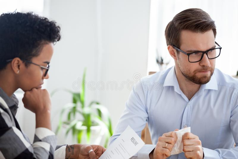 Stressed candidate man and boss during job interview royalty free stock photos