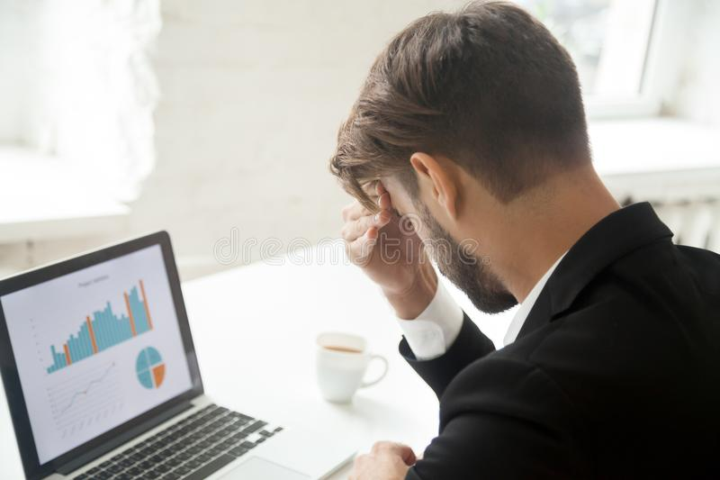 Stressed CEO disappointed with company falling rates stock photos