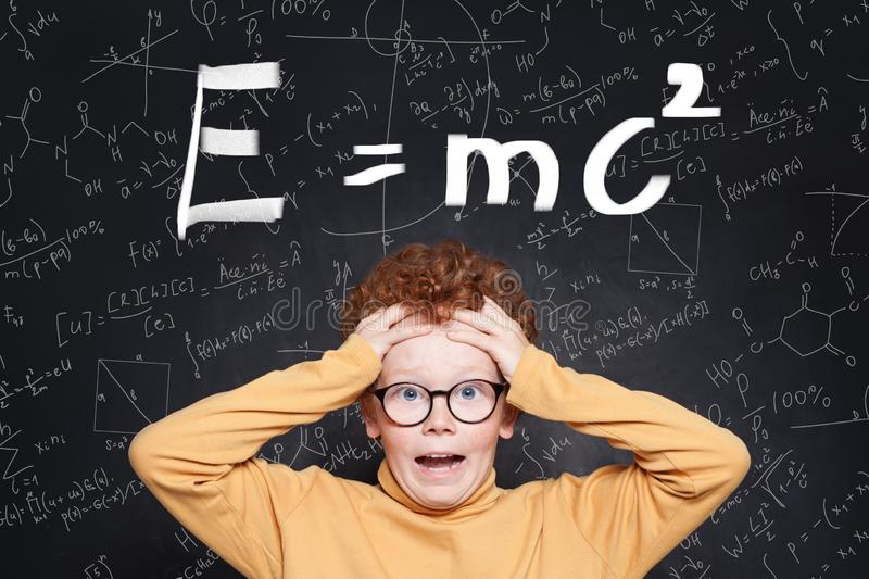 Stressed child in glasses on science background royalty free stock photography