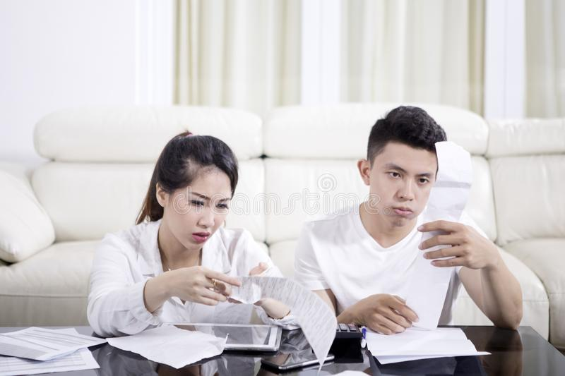 Stressed couple checking their high expenses royalty free stock image