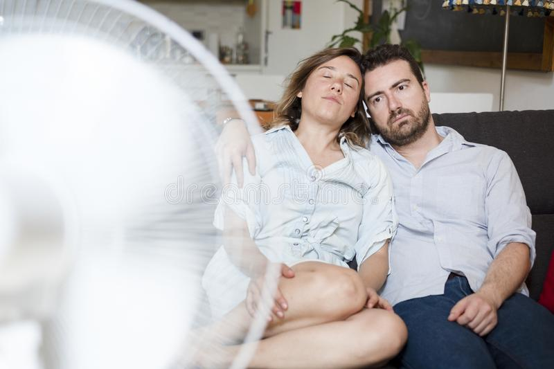 Tropical climate and air conditioner is needed. Stressed couple trying to refresh from summer heatwave stock photos
