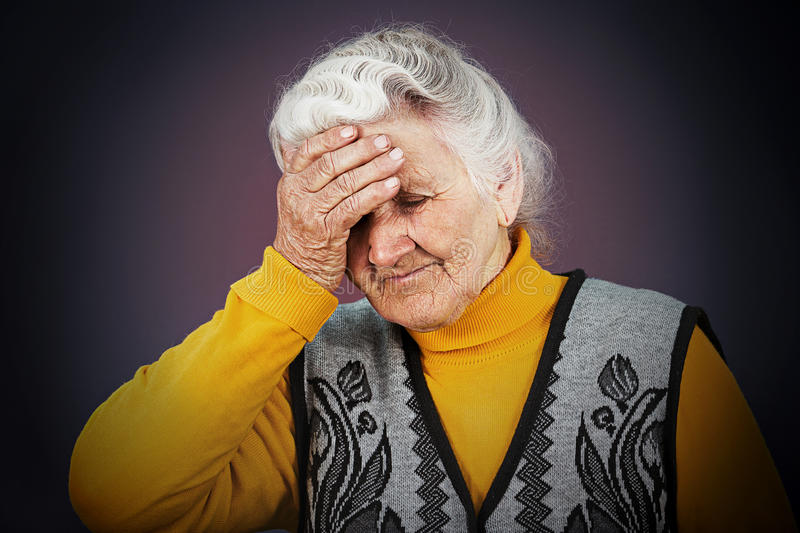 Stressed depressed elderly woman royalty free stock photography