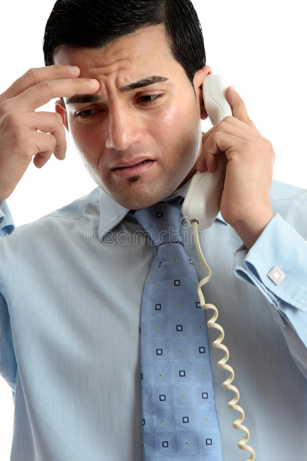 Stressed depressed man businessman on phone royalty free stock photography