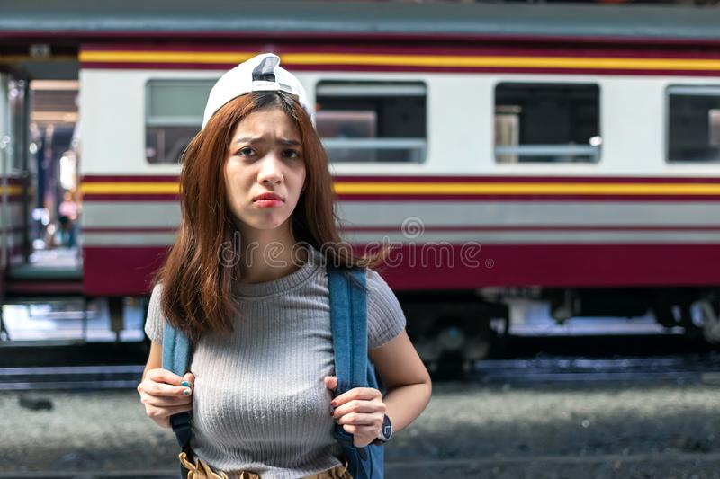 Stressed depressed young Asian lady tourist feeling shock and frustrated after miss a train. Problem and travel lifestyle concept royalty free stock image