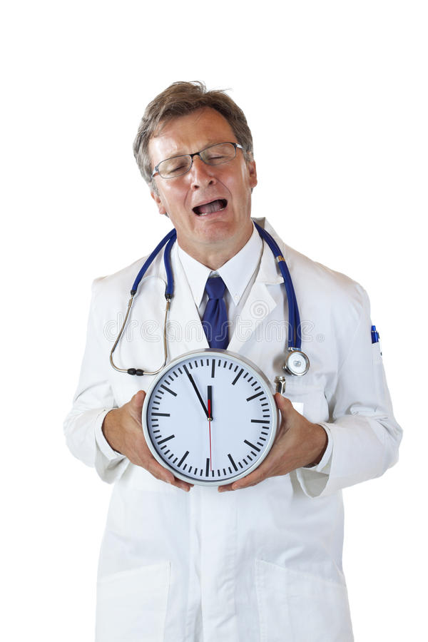 Stressed doctor cries because of time pressure. Stressed doctor with clock in front cries because of time pressure. Isolated on white background royalty free stock images