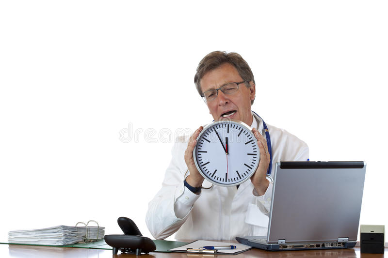 Stressed doctor holds clock and cries. Because of time pressure. Isolated on white background stock photos
