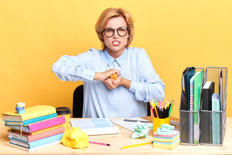 Stressed female entrepreneur has many problems at work, stock images