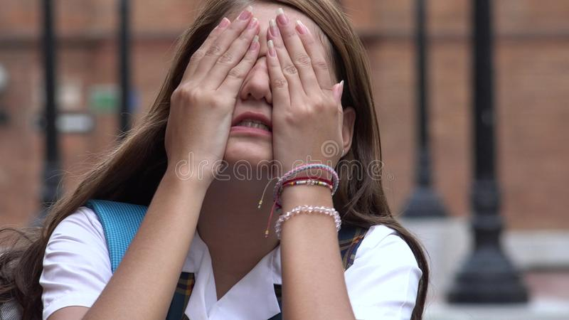 Stressed Female Teen Student Covering Her Eyes royalty free stock photo