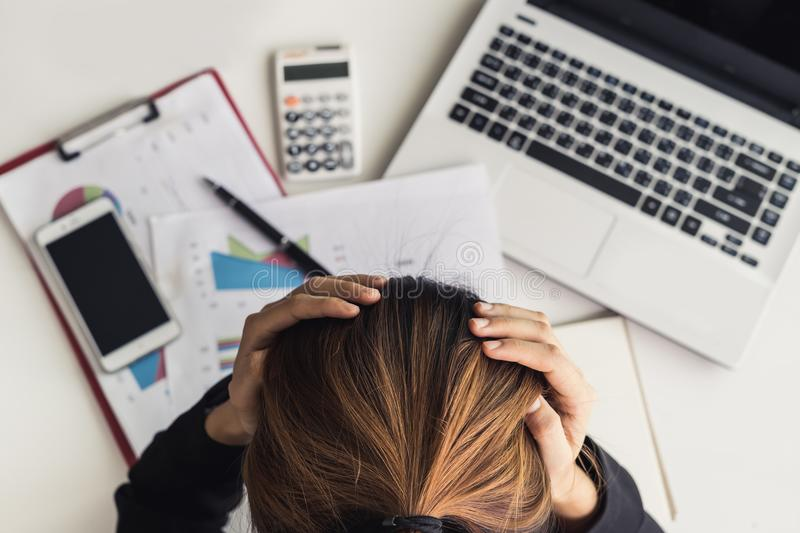 Stressed and frustrated asian business woman stock photo