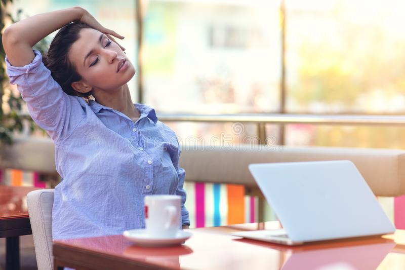 Stressed hipster businesswoman working on laptop in her office.  royalty free stock photography