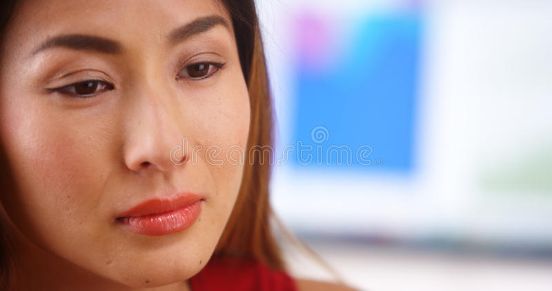 Stressed Japanese businesswoman royalty free stock images
