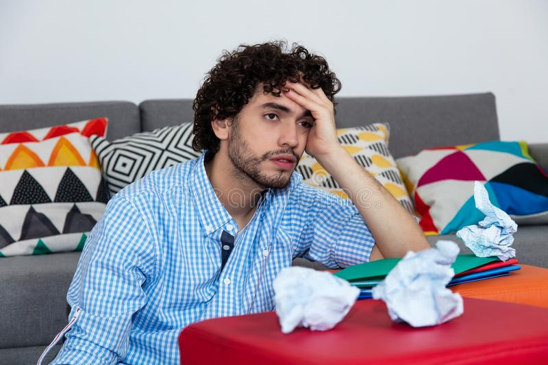 Stressed male student at home stock image