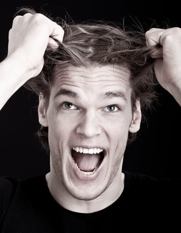 Stressed man pulling hair