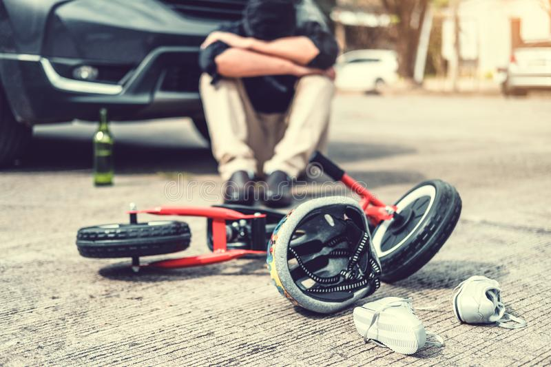 Stressed man suffering after Accident car crash with children`s bicycle stock photos