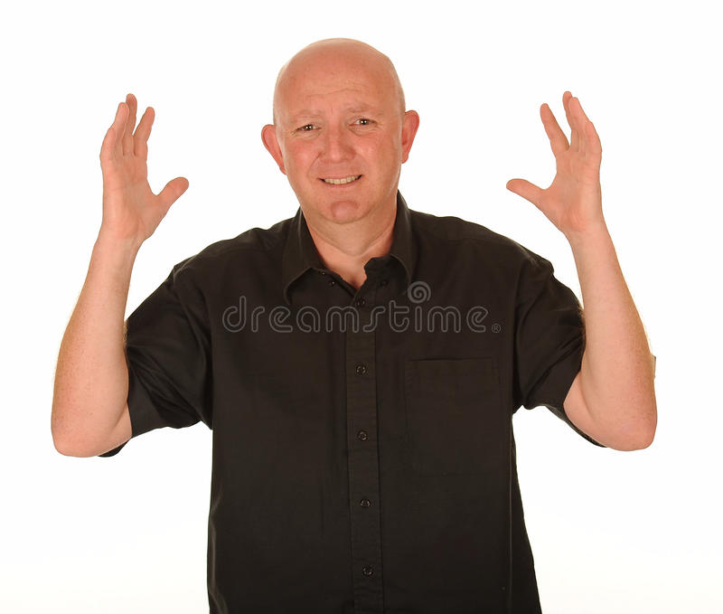 Stressed middle aged man. Half body portrait of stressed middle aged man with hands in air, white background royalty free stock image