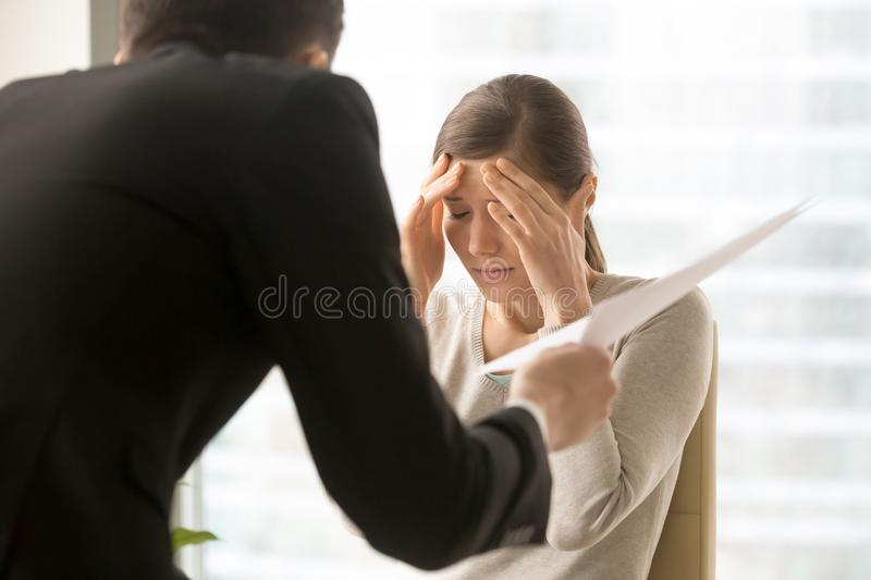 Female employee frustrated with angry boss claims royalty free stock image