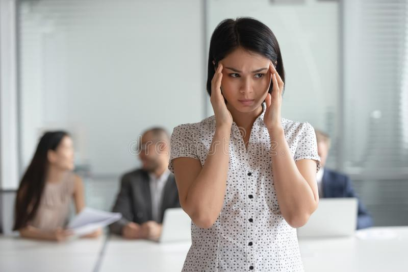 Stressed nervous asian business woman employee feel headache at work royalty free stock photos