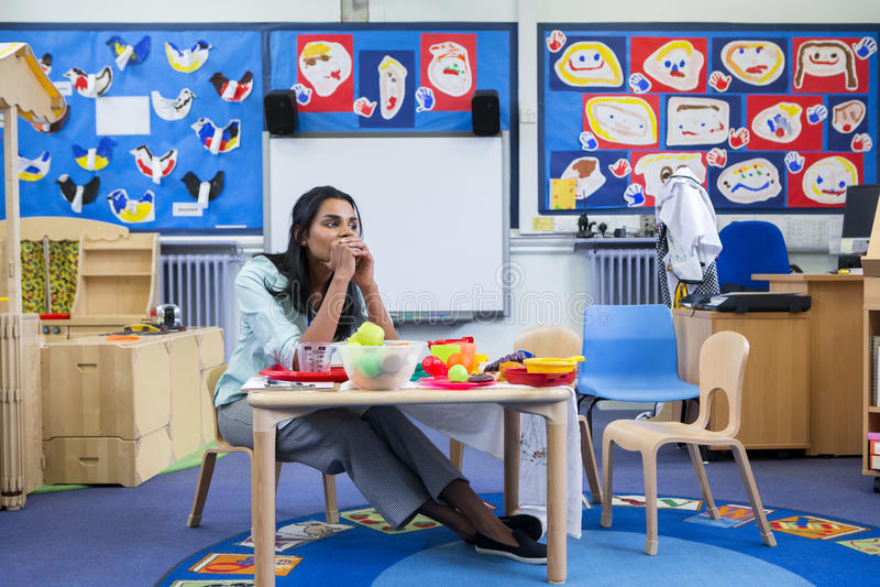 Stressed Nursery Teacher stock image