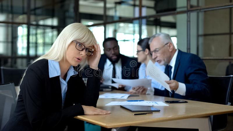 Stressed office manager listening to arguing colleagues, occupational burnout. Stock photo royalty free stock photography