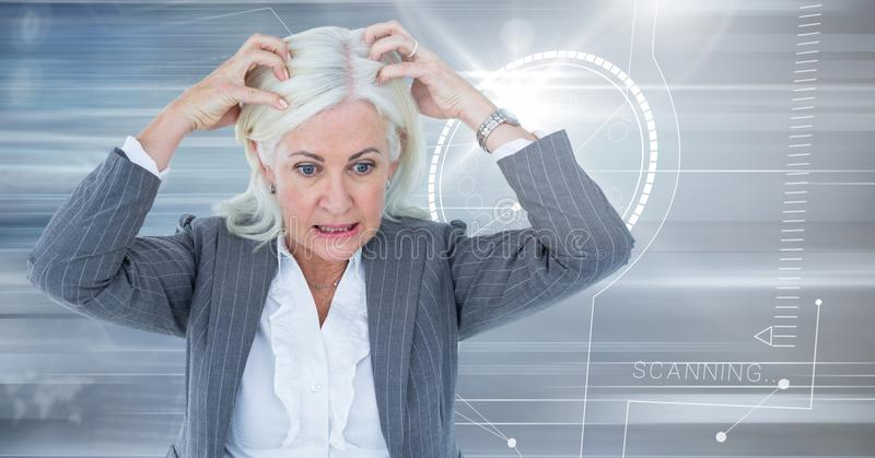 Stressed older woman with technology interface background stock image