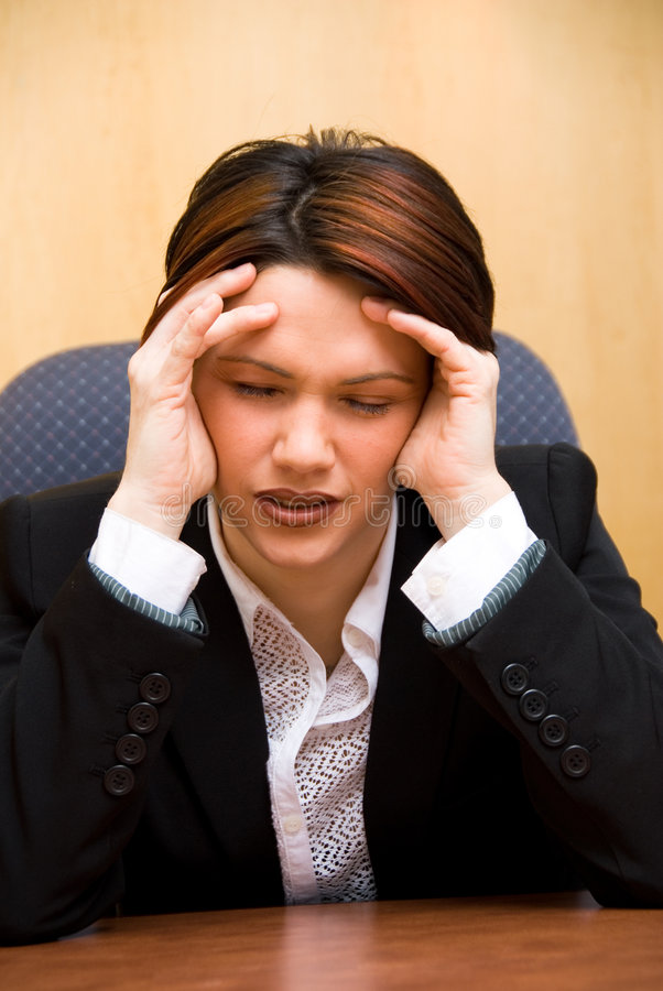 Stressed out. Burnout woman at her work holding her head royalty free stock photography