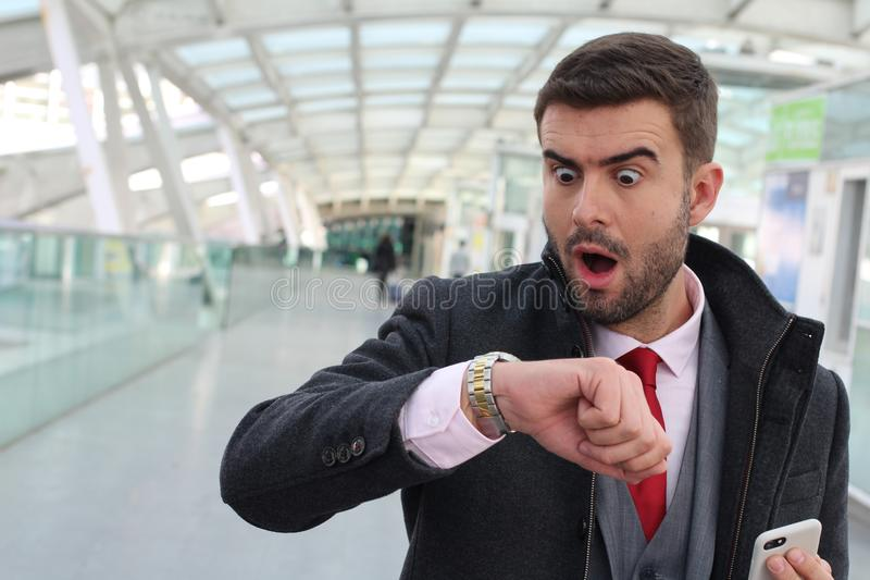 Stressed out businessman arriving really late royalty free stock image