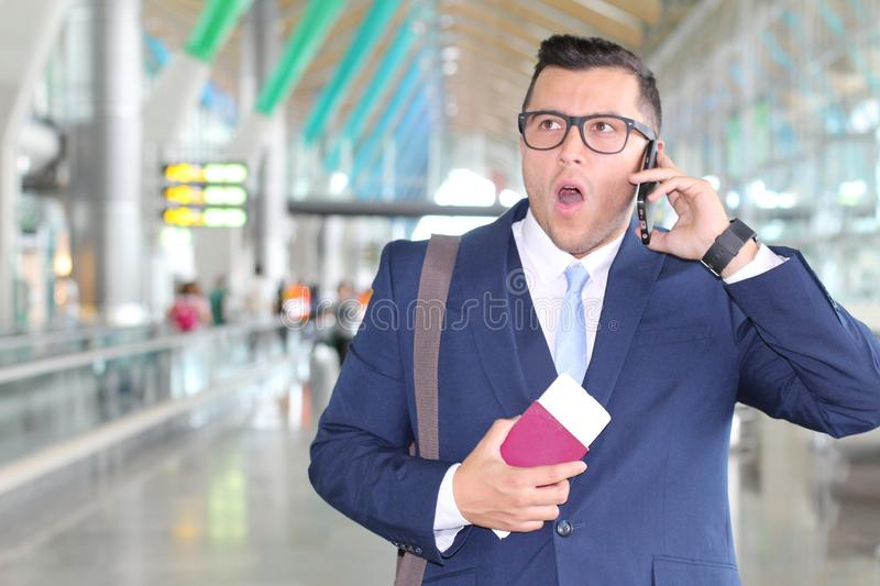 Stressed out businessman during a phone call at the airport stock photo