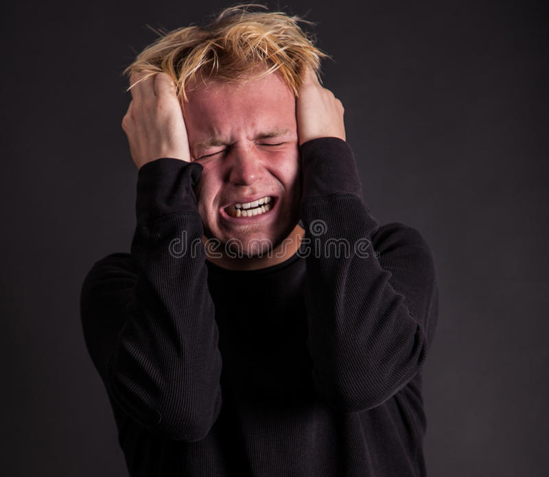 Stressed out male teenager royalty free stock photos