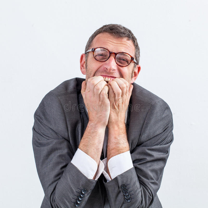 Stressed out middle aged businessman grinding teeth for anxiety stock photography