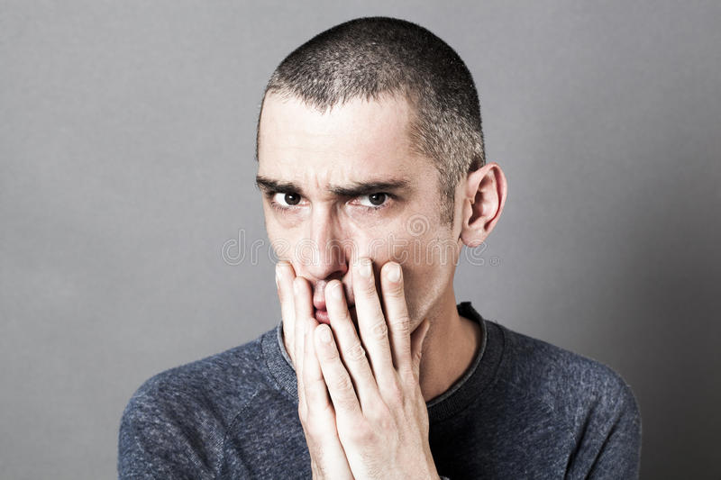 Stressed out unhappy man having doubts, showing suspicion and disappointment royalty free stock photos