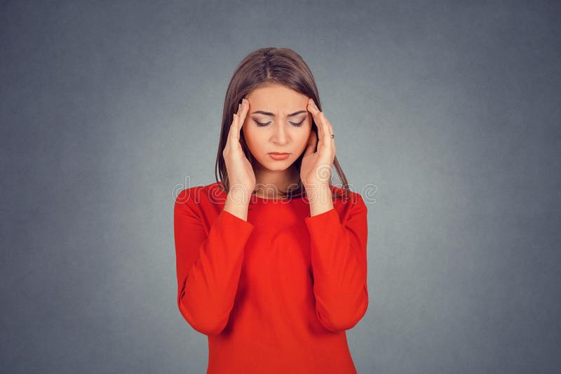 Stressed out young woman with worried face looking down stock images