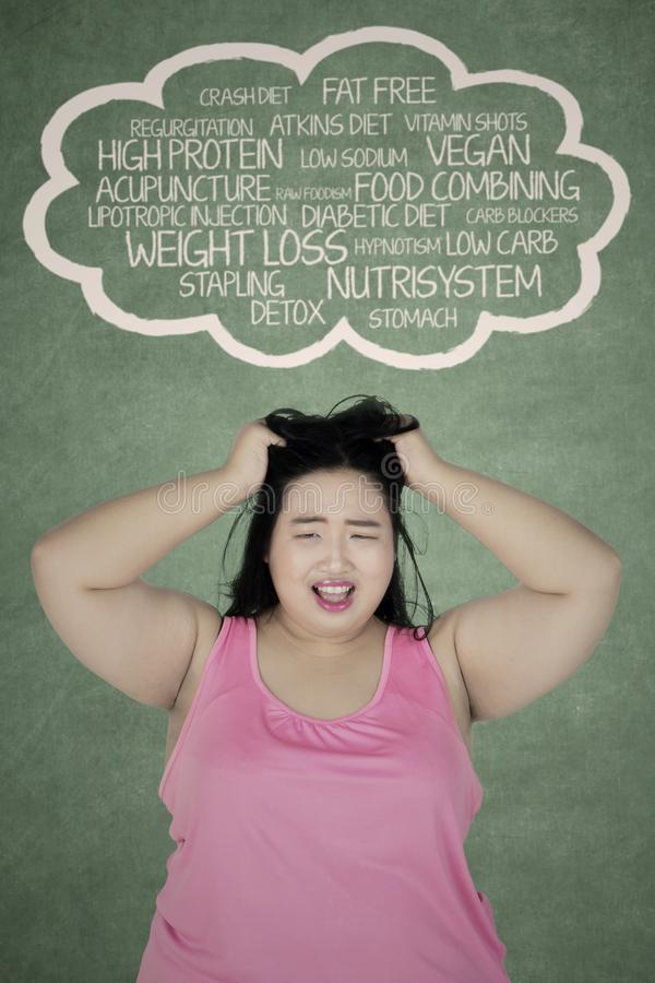 Stressed overweight woman thinking her problems royalty free stock photography