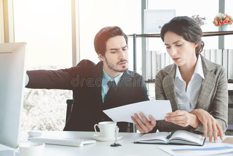 Stressed overwhelmed businessmen are discussing as a team briefing, stress at work concept. Close up royalty free stock photography