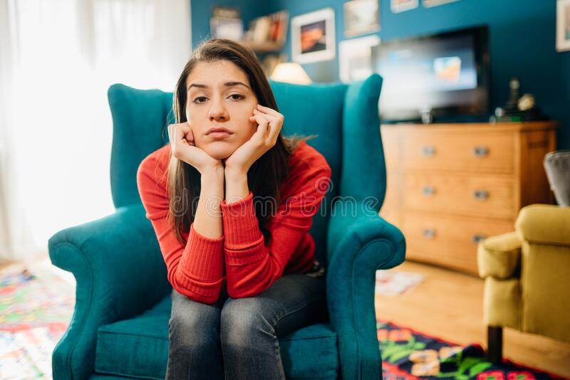 Stressed sad woman in bad mood overthinking problems.Bored staying at home mom.Quarantine mental health effect.Social distancing. Loneliness.Emotional challenge stock photo