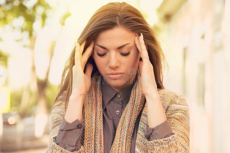 Stressed sad woman standing outdoors. City life style stress stock photos