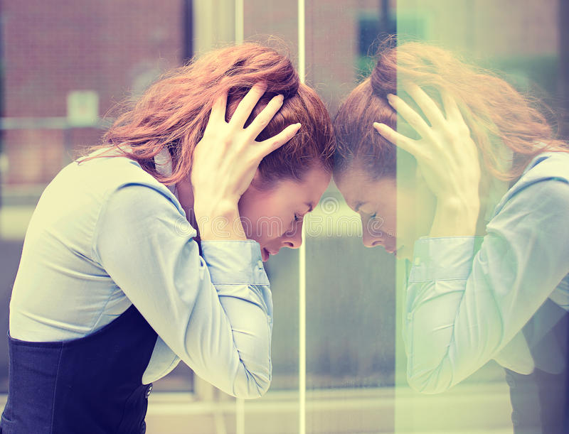 Stressed sad young woman outdoors. Urban life style stress. Portrait stressed sad young woman outdoors. City urban life style stress stock image