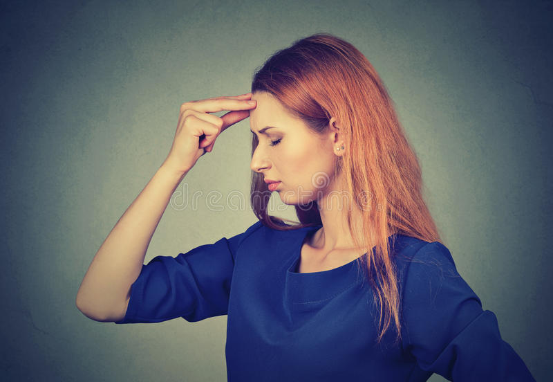Stressed sad young woman worried thinking royalty free stock photography
