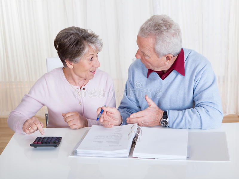 Stressed senior couple calculating budget stock images
